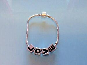 "Costume bracelett ideal for children young teenager charm type ""love"""