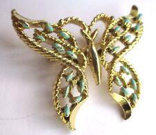 Belle broche couleur or pale forme de papillon émail bleu signée  GERRYS  2462