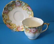 CUP & SAUCER WITH   FLOWERS IN A GOLD EDGE ON THE SAUCER & CUP  EXCELLENT CONDI