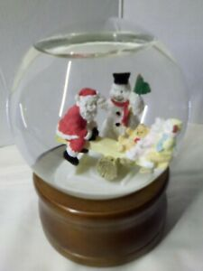 Glitter Dome by Roman Santa on Teeter Totter Musical Snow Globe