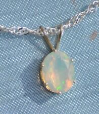 LUSTROUS  OVAL OPAL PENDANT 8.19mm X 6.21mm   0.74CT--STERLING SILVER SOLITARE.
