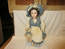 """Vintage 15"""" Porcelain Doll on Stand With Miniature Teddy Bear, Blue Bag and Hat"""