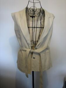 A WOMEN'S NEXT SLEEVELESS CREAM JACKET WITH BELT AND BUTTON FASTENER SIZE 16