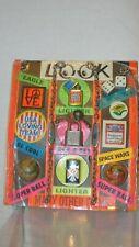 VINTAGE VENDING MACHINE DISPLAY CARD - LIGHTERS, DICE, ID BRACELET, ECT.