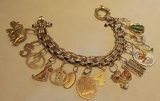 CHARMS BRACELET 14 KARAT GOLD& SAPPHIRE-15 CHARME RARE DESIGN :79.2 GR OR:2.545-
