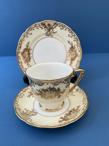 Vintage Meito China Hand Painted Japanese Richly Gilded Cup Saucer Plate Trio.