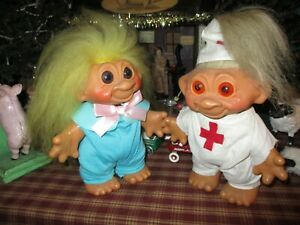 vintage troll dolls    lot of 2     7 inches tall....  cute  re dressed...