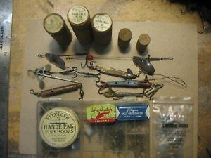 Vintage fishing tackle assortment.