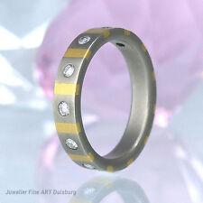 Ring in Titan/Gelbgold mit 7 Diamanten ca 0,30 ct Wesselton/VVSI