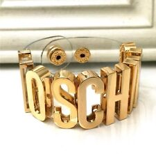 CLEAR Statement Bracelet Gold Fashion Jewellery Snap Popper Fasten Moschino