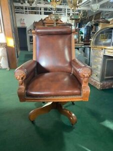 #7280 BROWN LEATHER AMERICAN OAK SWIVEL CHAIR WITH LIONS HEADS c. 1890 $2950