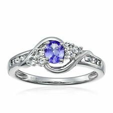 10k White Gold Oval Tanzanite and Round White Topaz Ring Size 7