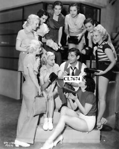 Clark Gable Autographing Handbags of Chorus Girls on Movie Set of 'Dancing Lady'