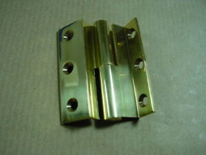 1 Messing-Möbelband links, gekröpft, Bandlänge 50 mm.
