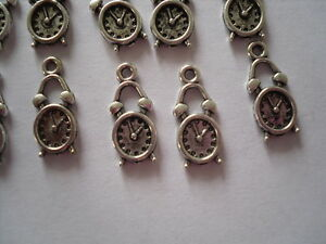 20 x silver tone clock charms approx 18mm x 7mm