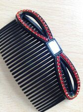A Beautiful Hair Comb With A Red Diamanté Studded Bow Feature