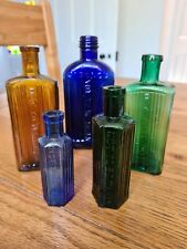 5 Colored Poison Bottles