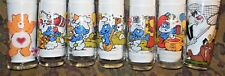 7 Promo Glasses  SMURFS (1983), CareBear (1983), Sylvester and Tweety (1976)
