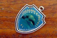 Vintage silver PRESERVE & PROTECT FLORIDA MANATEE TRAVEL SHIELD charm #E36