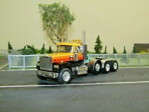 Dcp Custom yellow/black Mack Superliner daycab 4 axle heavyhaul tractor 1/64