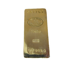 """GOLD BAR Paperweight. """"1 Kilo"""" Swiss Bank Corp. """"Nothing Feels Like Real Gold"""""""