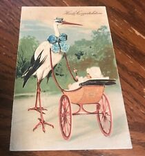 1907 HEARTY CONGRATULATIONS POSTCARD Stork baby in stroller with rattle