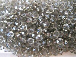 142 preciosa squished spacer crystal bicone beads,5x3mm Black Diam.