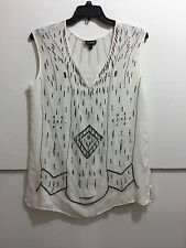 Bebe women's size large sheer sleeveless shirt with beaded detail