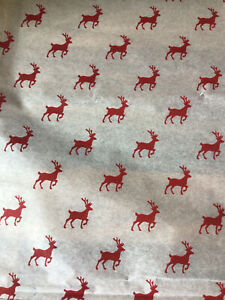 White christmas with red reindeer tissue paper