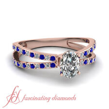 1.50 Carat Oval Shaped Diamond And Round Sapphire Split Band Engagement Rings
