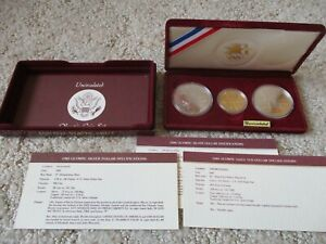 1983-1984 Olympic 3 coin uncirculated set, 2 Silver Dollar & 1 Gold $10 coin