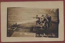 US Navy Sailors manning ship gun qp2