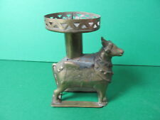 Antique brass candle holder with cow