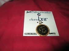 Belk Silverworks initial E charm-24 kt gold over fine silver plate- retail 40.00