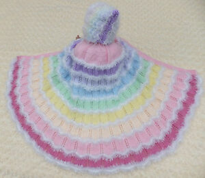 KNITTING PATTERN (PAPER) TO MAKE 'WRAPPED IN A RAINBOW' BABY/DOLL HOODED CAPES.