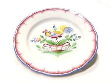 Assiette coq sur une patte faïence décor Lunéville signée R C