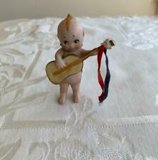 """Rare All Bisque O'Neill Kewpie 3 1/2"""" Doll With Guitar & Ribbons Labels Attached"""