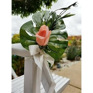 Wedding pew chair decor tropical flowers and foliage