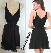 NWT bebe Cutout Deep V-Neck Dress Size L Sexy Black  dress MSRP $148.00