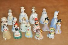Collection of 14 lady bells and 2 character bells