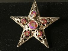 Star Brooch with Scroll Design and Pink Stones