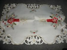 Christmas table mat polyester;  white with red candles and gold coloured thread