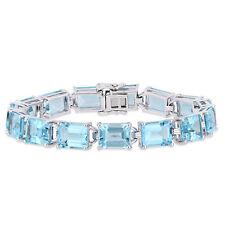 Amour Sterling Silver Blue Topaz Tennis Bracelet