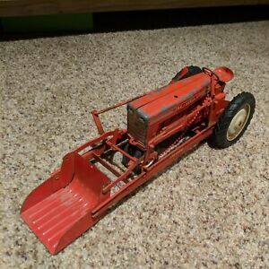 1960s Carter Tru Scale farm tractor with loader scoop.