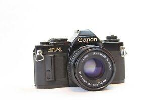 Canon AV-1 SLR 35mm Camera With 50mm FD Lens SN: 826671 Tested and CLA'd