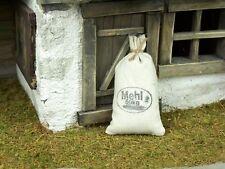 Mehlsack mit Druck aus Stoff, Höhe. 7 cm.  Weihnachtskrippe oder Puppenhaus