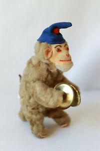 Jouet singe ancien articulé en peluche