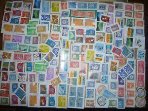 40 grams mixtures Swiss Interna. Organization stamps on single paper kiloware