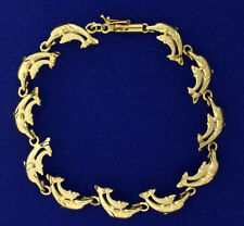 Dolphin Link Bracelet in yellow gold 10k yellow gold 7 inches long 10mm wide
