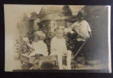 Vintage RPPC Postcard Three Children Wagon Backyard Girls Boy Bows Playing Doll